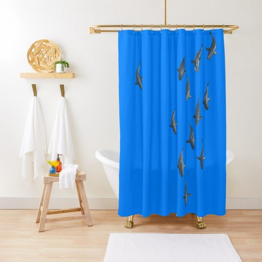 Beautiful trendy and modern shower curtain with a school of sharks swimming in the deep blue sea.