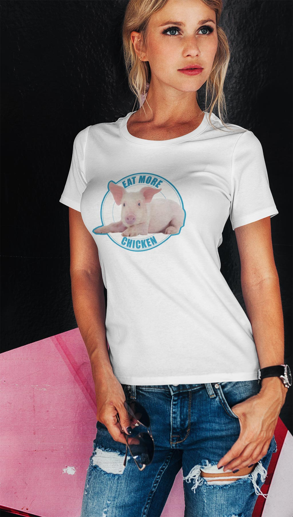 Eat more chicken. A beautiful blonde woman wearing a cute piglet t-shirt.
